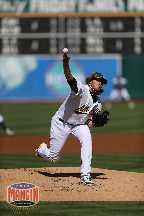 OAKLAND, CA - JUNE 15:  A.J. Griffin #64 of the Oakland Athletics pitches against the Seattle Mariners during the game at O.co Coliseum on Saturday June 15, 2013 in Oakland, California. Photo by Brad Mangin