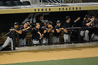 The Wake Forest Demon Deacons bench watches from the dugout during the game against the West Virginia Mountaineers in Game Six of the Winston-Salem Regional in the 2017 College World Series at David F. Couch Ballpark on June 4, 2017 in Winston-Salem, North Carolina.  The Demon Deacons defeated the Mountaineers 12-8.  (Brian Westerholt/Four Seam Images)