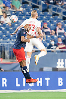 FOXBOROUGH, MA - MAY 22: Andrew Farrell #2 of New England Revolution and Daniel Royer #77 of New York Red Bulls compete for a high ball during a game between New York Red Bulls and New England Revolution at Gillette Stadium on May 22, 2021 in Foxborough, Massachusetts.
