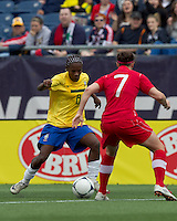 Brazilian midfielder Formiga (8) dribbles. In an international friendly, Canada defeated Brasil, 2-1, at Gillette Stadium on March 24, 2012.