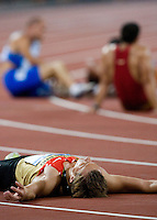 22 AUG 2008 - BEIJING, CHN - Michael Schrader (GER) recovers after recording the fastest time in the Decathlon 1500m rounds - Beijing Olympics. (PHOTO (C) NIGEL FARROW) *** IOC RULES APPLY ON USAGE ***