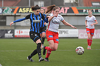Febe Vanhaecke (3) of Club Brugge and Anne-Lore Scherrens (22) of Zulte-Waregem  pictured during a female soccer game between SV Zulte - Waregem and Club Brugge YLA on the 13 th matchday of the 2020 - 2021 season of Belgian Scooore Womens Super League , saturday 6 th of February 2021  in Zulte , Belgium . PHOTO SPORTPIX.BE   SPP   DIRK VUYLSTEKE