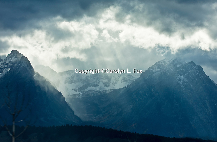 Storm clouds & God rays hover over the Teton Mountain Range in Wyoming.