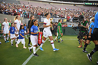 PASADENA, CALIFORNIA - August 03: USWNT and Ireland walk out during their international friendly and the USWNT Victory Tour match between Ireland and the United States at the Rose Bowl on August 03, 2019 in Pasadena, CA.