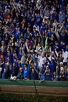 General view of Chicago Cubs fans celebrating a Dexter Fowler (not shown) home run in the eighth inning during Game 4 of the Major League Baseball World Series against the Cleveland Indians on October 29, 2016 at Wrigley Field in Chicago, Illinois.  (Mike Janes/Four Seam Images)