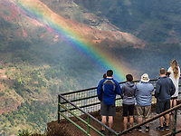 People enjoy the view of Wamea Canyon with a rainbow, Kaua'i.