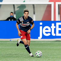 FOXBOROUGH, MA - SEPTEMBER 23: Matt Polster #8 of New England Revolution dribbles at midfield during a game between Montreal Impact and New England Revolution at Gillette Stadium on September 23, 2020 in Foxborough, Massachusetts.