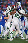 New York Jets Mike Pennel (98) and Leonard Williams (92) tackle Chris Ivory (33) during an NFL football game against the Buffalo Bills, Sunday, December 9, 2018, in Orchard Park, N.Y.  (Mike Janes Photography)