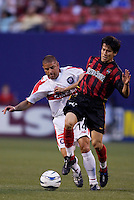 The MetroStars' Joselito Vaca and the Chicago Fire's Chris Armas battle for the ball. The Chicago Fire played the NY/NJ MetroStars to a one all tie at Giant's Stadium, East Rutherford, NJ, on May 15, 2004.