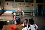 Father Laborde playfully teases a child at Asha Neer a home for poor and diabled on Andul Road in Howrah.  West Bengal, India, Arindam Mukherjee/Agency Genesis