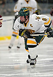 """19 January 2007: University of Vermont defenseman and co-captain Kenny Macaulay from Baddeck, NS, in action against Boston College at Gutterson Fieldhouse in Burlington, Vermont. The UVM Catamounts defeated the BC Eagles 3-2 before a record setting 50th consecutive sellout at """"the Gut""""...Mandatory Photo Credit: Ed Wolfstein Photo."""