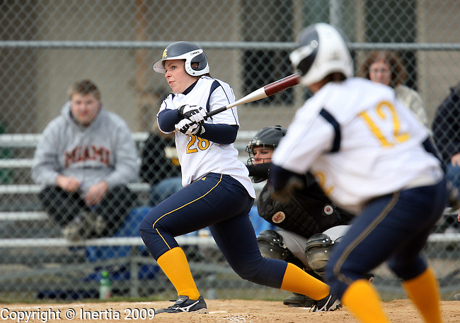 SIOUX FALLS, SD - APRIL 10:  Traci Fransen #28 of Augustana watches the ball drop in for a base hit to plate two runs against Northern State in the second game of their doubleheader Friday afternoon at Bowden Field. (Photo by Dave Eggen/Inertia)