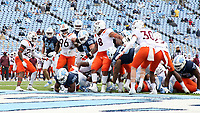 CHAPEL HILL, NC - OCTOBER 10: Javonte Williams #25 of North Carolina plunges into the end zone for the game's first touchdown during a game between Virginia Tech and North Carolina at Kenan Memorial Stadium on October 10, 2020 in Chapel Hill, North Carolina.