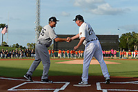 Tampa Yankees manager Dave Bialas (36) manager greets Lakeland Flying Tigers manager Dave Huppert (24) at home plate before a game on April 9, 2015 at Joker Marchant Stadium in Lakeland, Florida.  Tampa defeated Lakeland 2-0.  (Mike Janes/Four Seam Images)