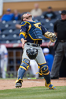 California Golden Bears catcher Brett Cumberland (28) tracks a pop fly during the game against the Duke Blue Devils at Durham Bulls Athletic Park on February 20, 2016 in Durham, North Carolina.  The Blue Devils defeated the Golden Bears 6-5 in 10 innings.  (Brian Westerholt/Four Seam Images)