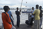 Fishermen on the Suriname River in the capital city of Paramaribo, Suriname.