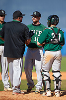 Farmingdale Rams head coach Keith Osik (jacket) talks with starting pitcher Kevin Martinez (11) and catcher Joseph Roche (30) during a game against the Union Dutchmen on February 21, 2016 at Chain of Lakes Stadium in Winter Haven, Florida.  Farmingdale defeated Union 17-5.  (Mike Janes/Four Seam Images)