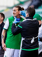 24th April 2021; Easter Road, Edinburgh, Scotland; Scottish Cup fourth round, Hibernian versus Motherwell; Jackson Irvine of Hibernian receives treatment for cut on the ear