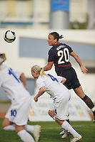 US forward #20 Abby Wambach heads a ball across the goal mouth vs Iceland during a 2010 Algarve Cup game in Vila Real Sto. Antonio, Portugal.