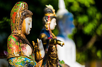 Small, colorful buddha statues close-up in the gardens of Wat Phra That temple, in Doi Suthep mountains near Chiang Mai Thailand Southeast Asia
