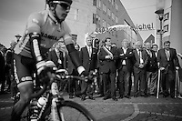 King Filip of Belgium (with light-colored tie) waits for all riders to join the startgrid, before flagging off this 100th edition of 'La Doyenne' ('The Oldest')<br /> Notice cycling legend Eddy Merckx (BEL) on crutches to the right.<br /> <br /> Liège-Bastogne-Liège 2014