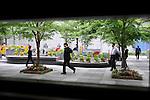 Japanese businessman in the garden in front of the Restaurant Sant Pau, Tokyo.<br /> <br /> Homme d'affaires japonais dans le jardin devant le restaurant Sant Pau, Tokyo.