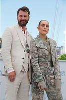 """CANNES, FRANCE - JULY 13:  Hilmir Snaer Gudnason, Noomi Rapace at the """"Lamb"""" photocall during the 74th annual Cannes Film Festival on July 13, 2021 in Cannes, France. <br /> CAP/GOL<br /> ©GOL/Capital Pictures"""