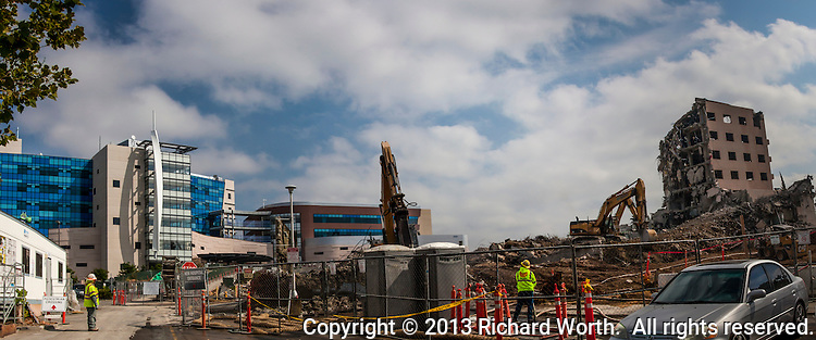 The brand new Eden Medical Center, surrounded by construction crew and heavy equipment.   On the left, the Hospital Building.  Next to it is the Medical Office Building.  On the right are the disappearing remains of Castro Valley's old Eden Hospital, being deconstructed, demolished.  July 2013.
