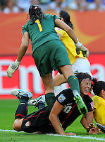 Abby Wambach of team USA and goalkeeper Andreia of team Brazil during the FIFA Women's World Cup at the FIFA Stadium in Dresden, Germany on July 10th, 2011.