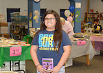 this is the fourth year that fourth-grader Kimberly has been able to pick out six free books to add to her home libraries, thanks to Books Between Kids.