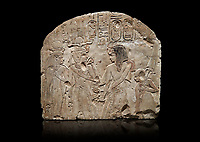 Ancient Egyptian stele depicting Sethy I adoring Amenhotep I and Nefertari, limestone, New Kingdom, 19th Dynasty, (1279-1213 BC), Deir el-Medina,  Egyptian Museum, Turin. Black background. Schiaparelli Cat 6189.