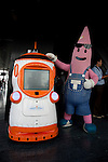 """August 01 2012, Tokyo, Japan -  (L to R) The new robot guide """"Tawabo"""" recharges its battery next to Noppon, character of Tokyo Tower. Tokyo Tower implemented the new robot guide which name is """"Tawabo"""", the first indoor robot guide in Japan. It can speak Japanese, English, Chinese and Korean, it weights 200kg and it is 160cm tall."""
