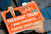 "An audience member holds a sign reading ""President Trump / Make commercial fishing great again"" before Donald Trump, Jr., the son of US president Donald Trump, speaks at a 'Make America Great Again!' campaign rally at DoubleTree by Hilton MHT in Manchester, New Hampshire, on Thu., Oct. 29, 2020. The event took place five days before the Nov. 3 presidential election."