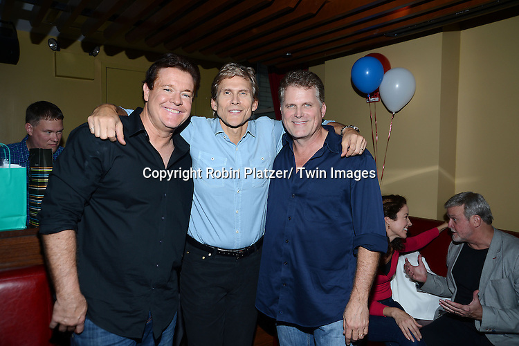 Michael O' Leary, Grant Aleksander and Robert Newman attend Daytime Stars and Strikes Charity Event benefitting The American Cancer Society on October 13, 2013 at Bowlmore Lanes in Time Square in New York City.
