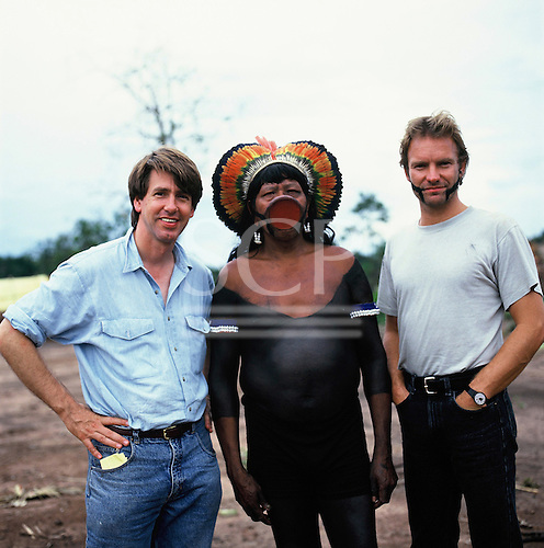 Pavuru village, Brazil. Sting with Larry Cox and Chief Raoni of the Megranoti-Kayapo; Xingu Indigenous area, Nov 1990.