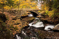 Peak Color Surrounds the Historic Stone Arch Bridge at Gleason Falls in Hillsboro, NH