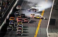 Feb 07, 2009; Daytona Beach, FL, USA; NASCAR Sprint Cup Series driver Brian Vickers (83) leads the field as Greg Biffle (16) and Dale Earnhardt Jr (88) spin during the Bud Shootout at Daytona International Speedway. Mandatory Credit: Mark J. Rebilas-