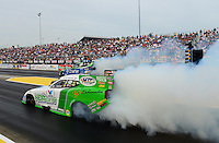 Sept. 30, 2012; Madison, IL, USA: NHRA funny car driver Jack Beckman (near lane) burns out alongside Tony Pedregon during the Midwest Nationals at Gateway Motorsports Park. Mandatory Credit: Mark J. Rebilas-