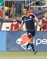New England Revolution midfielder Diego Fagundez (14) dribbles down the wing. In a Major League Soccer (MLS) match, the New England Revolution (blue) defeated Chicago Fire (red), 2-0, at Gillette Stadium on August 17, 2013.