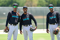 Miami Marlins Angeudis Santos (58), Richard Roman (87), and Jandel Paulino (84) during a Minor League Spring Training camp day on April 28, 2021 at Roger Dean Chevrolet Stadium Complex in Jupiter, Fla.  (Mike Janes/Four Seam Images)
