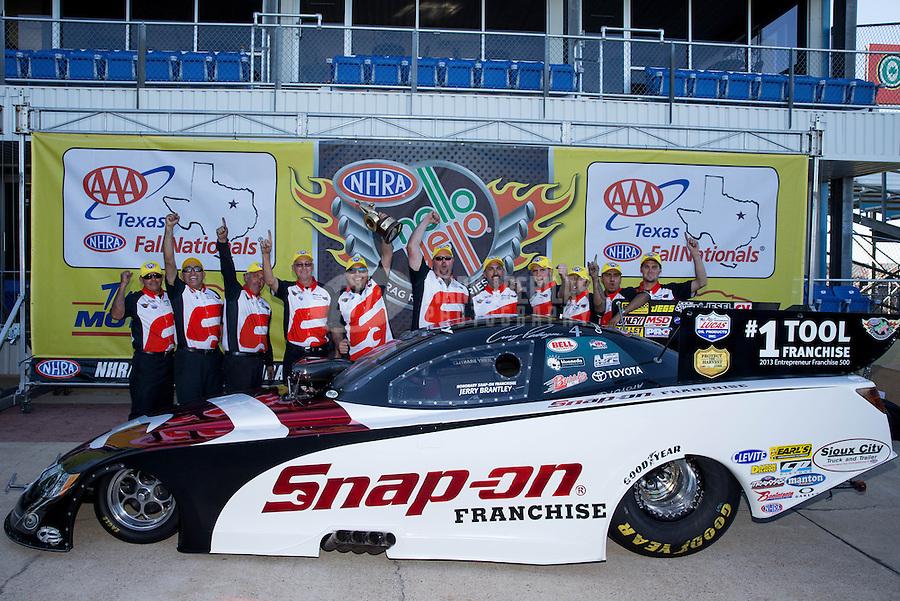 Sept. 22, 2013; Ennis, TX, USA: NHRA funny car driver Cruz Pedregon celebrates with his crew after winning the Fall Nationals at the Texas Motorplex. Mandatory Credit: Mark J. Rebilas-