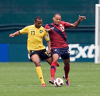 Jermaine Jones (13) of the USMNT  fights for the ball with Rodolph Austin (17) of Jamaica during the game at RFK Stadium in Washington, DC.  The USMNT defeated Jamaica, 2-0.