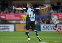 Michael Harriman of Wycombe Wanderers questions a decision during the Capital One Cup match between Wycombe Wanderers and Fulham at Adams Park, High Wycombe, England on 11 August 2015. Photo by Andy Rowland.