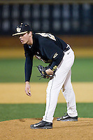 Wake Forest Demon Deacons relief pitcher Garrett Kelly (28) looks to his catcher for the sign against the Georgetown Hoyas at Wake Forest Baseball Park on February 16, 2014 in Winston-Salem, North Carolina.  The Demon Deacons defeated the Hoyas 3-2.  (Brian Westerholt/Four Seam Images)