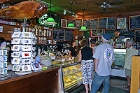 "Shoppers stop for a little """"pick me up"""" at the Coffee Gallery. Gallery features a variety of kona coffees as well as international coffee blends and gifts.Located in the North Shore Marketplace in the town of Haleiwa on Oahu's north shore."
