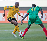 CARSON, CA – June 6, 2011: Jamaican Luton Shelton (21) attempts to get past Greneda player Benedict Modest (11) during the match between Grenada and Jamaica at the Home Depot Center in Carson, California. Final score Jamaica 4 and Grenada 0.