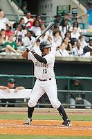 Charleston RiverDogs catcher Alvero Noriega (13) at bat during a game against the Augusta GreenJackets at Joseph P.Riley Jr. Ballpark on April 15, 2015 in Charleston, South Carolina. Charleston defeated Augusta 8-0. (Robert Gurganus/Four Seam Images)