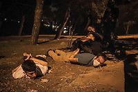 Protesters lay on the grass as they are arrested in the streets nearby Taksim Square during night clashes in a masive rally against the turkish government in Istanbul, Turkey.