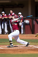 Babe Thomas (8) of the Winthrop Eagles follows through on his swing against the Kennesaw State Owls at the Winthrop Ballpark on March 15, 2015 in Rock Hill, South Carolina.  The Eagles defeated the Owls 11-4.  (Brian Westerholt/Four Seam Images)