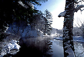 Winter scene alone the Dead River near Marquette, Michigan, in the Upper Peninsula.